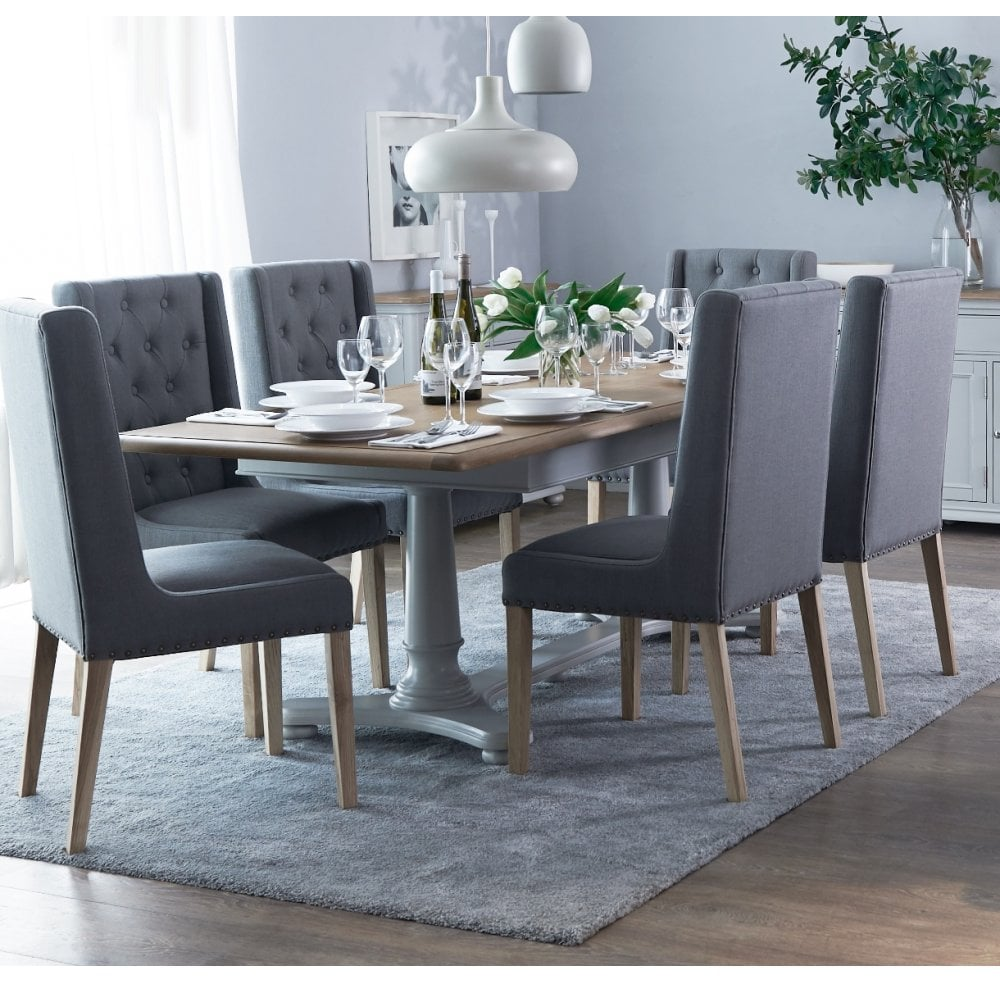Mottistone 2 1m Extending Table And 8 Button And Studded Dining Chairs Furniture Sale From Readers Interiors Uk
