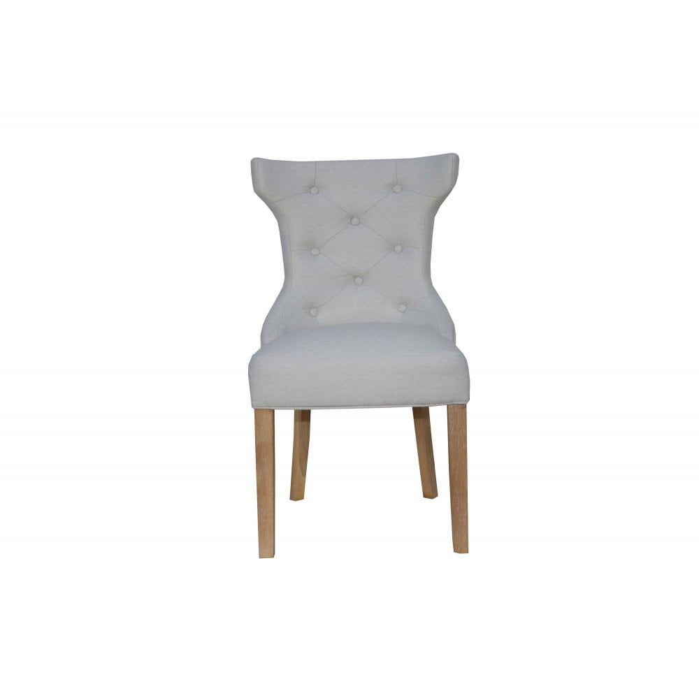 Upholstered Dining Chairs Winged Button Back Chair With Metal Ring Natural Furniture Sale From Readers Interiors Uk